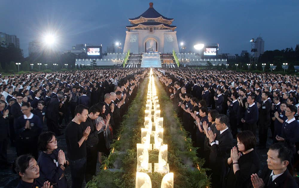 Taiwanese people pray together during the Taiwan National Buddha`s Birthday celebration in front of the Chiang Kai-shek Memorial Hall in Taipei, Taiwan.