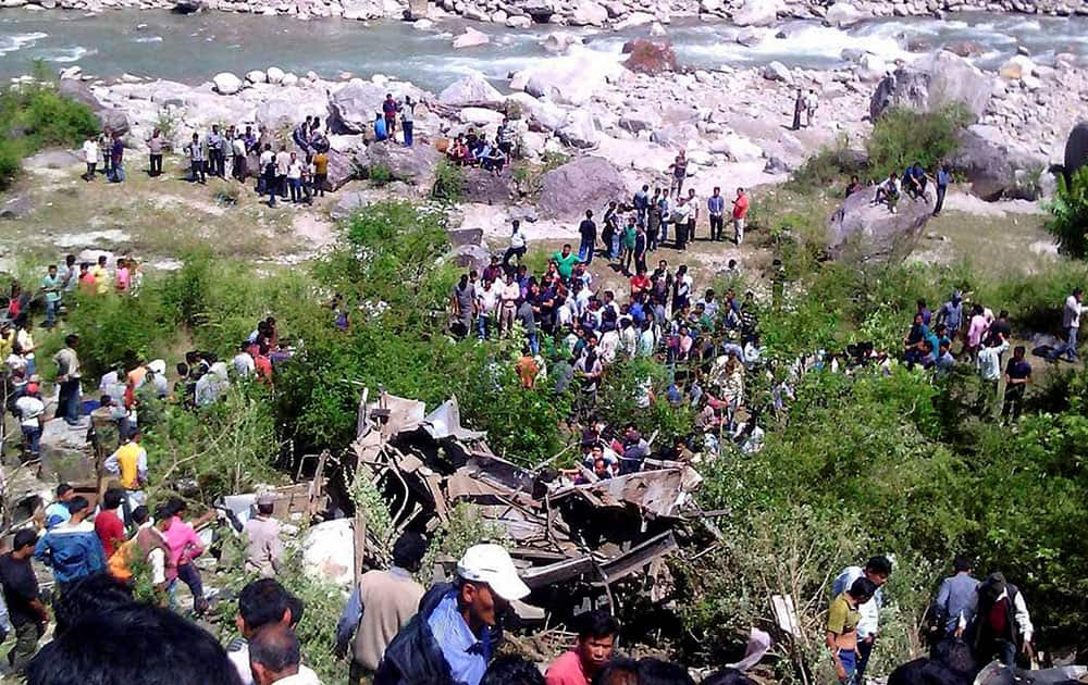 Rescue work is carried out after a bus fell into River Mandakini in Chamoli district.