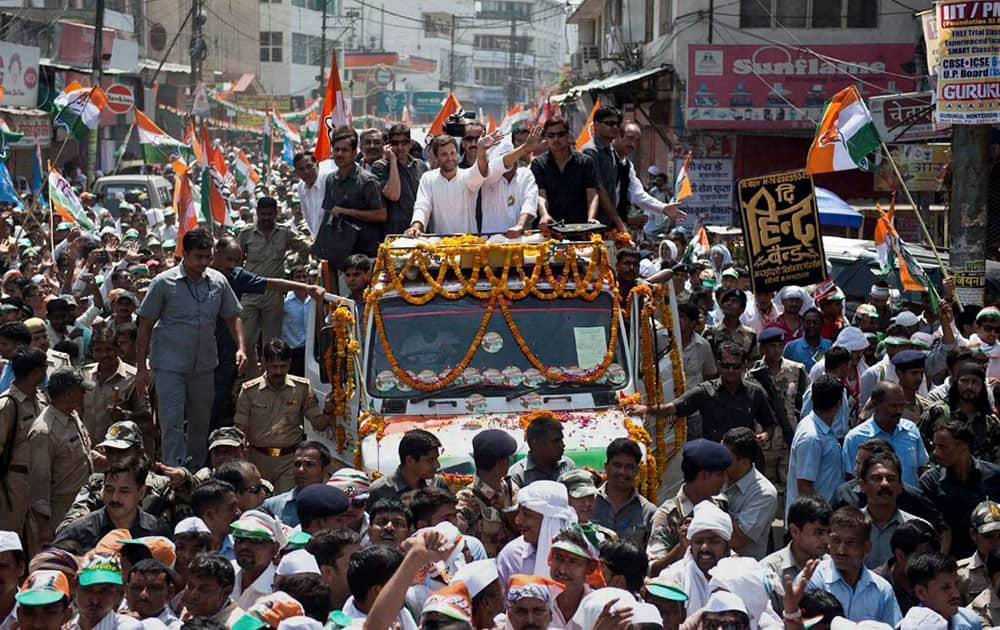 Congress Vice President Rahul Gandhi waves during road show for party candidate Ajay Rai in Varanasi.