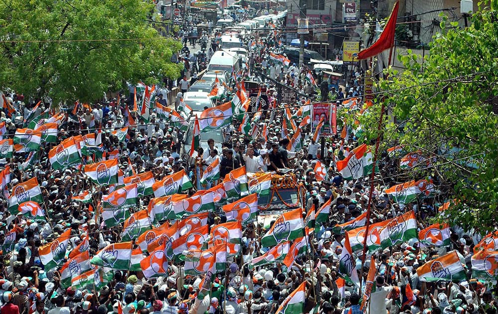 Supporters during Congress Vice President Rahul Gandhi`s road show for party candidate Ajay Rai in Varanasi.