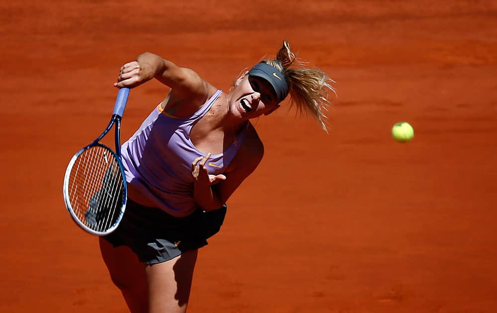 Maria Sharapova from Russia serves the ball during a Madrid Open tennis tournament match against Li Na from China in Madrid, Spain.