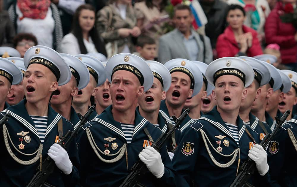 Russian Black Sea fleet sailors salute during the Victory Day military parade, which commemorates the 1945 defeat of Nazi Germany, in Sevastopol, Russia.