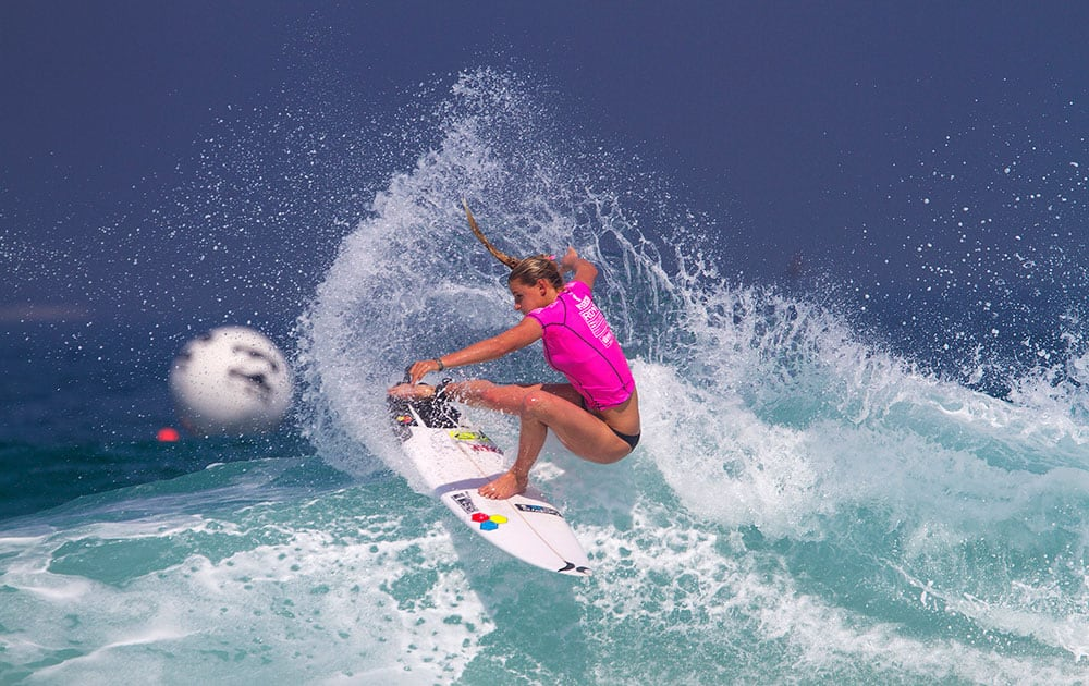 This photo provided by the Association of Surfing Professionals (ASP), Lakey Peterson, of the United States, cuts back on a wave during her round 3 heat in the Billabong Rio Pro surfing competition, in Rio de Janeiro, Brazil.