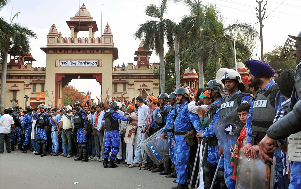 RAF personnel guard during BJP PM candidate Narendra Modi`s election road show in Varanasi.