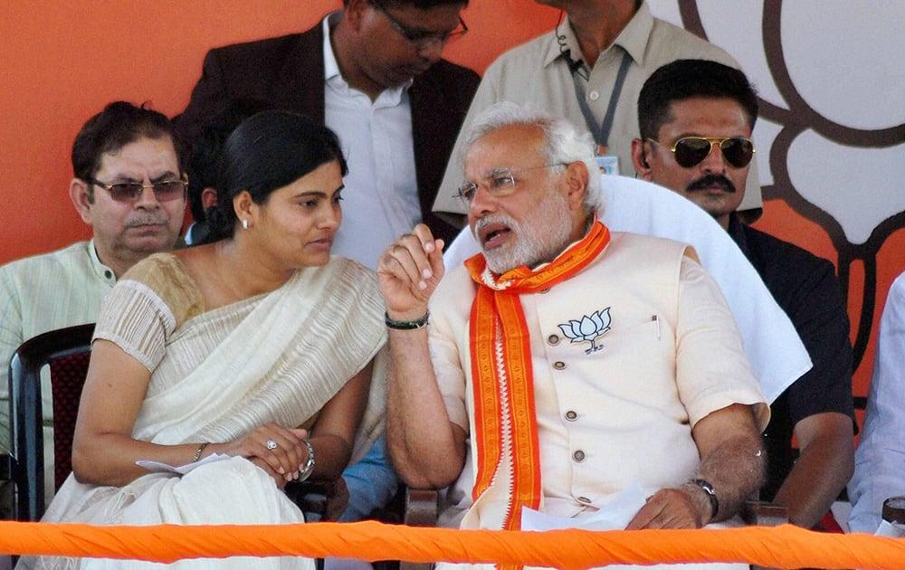BJP`s PM candidate Narendra Modi and Apna Dal Chief Anupriya Patel at an election campaign rally in Varanasi.