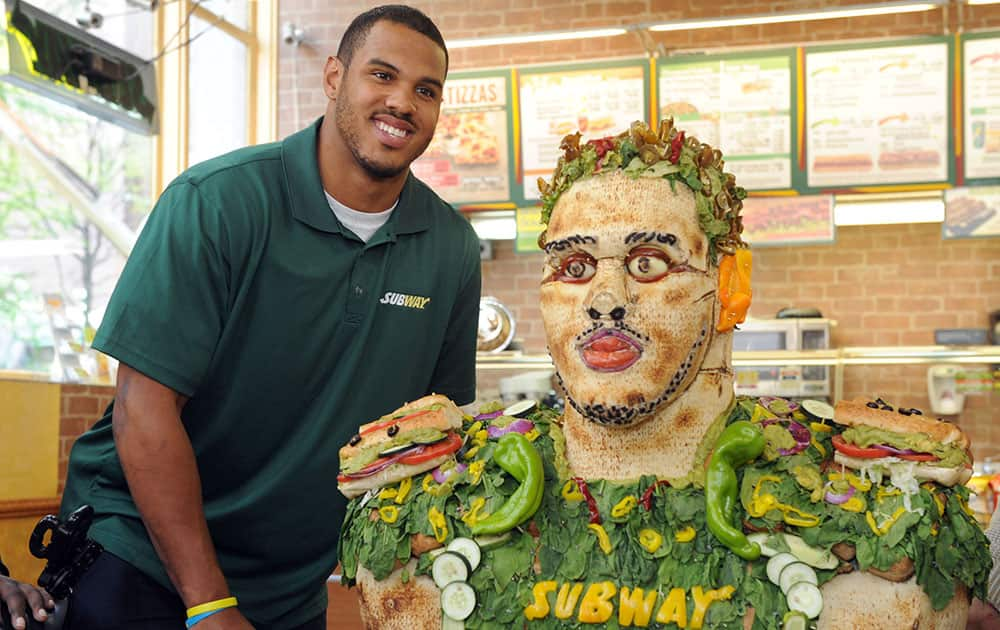 Anthony Barr, 2014 draft prospect and newest SUBWAY Famous Fan, poses with a life-size food statue made of fresh vegetables, in New York. Barr joins a roster of fellow Famous Fans that include Robert Griffin III, Justin Tuck, Russell Westbrook, Pele and Michael Phelps.