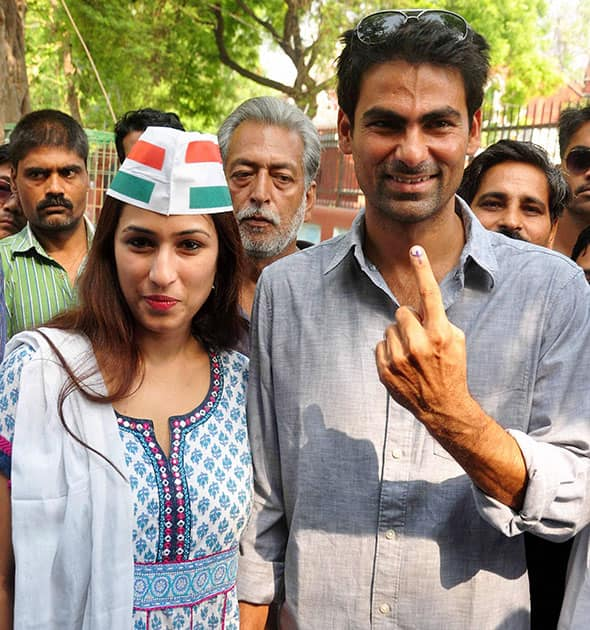 CRICKETER AND CONGRESS CANDIDATE MOHD. KAIF FOR PHULPUR SEAT WITH HIS WIFE POOJA YADAV SHOWS HIS INK MARK FINGER AFTER CASTING VOTE FOR 8TH PHASE OF LOK SABHA ELECTION IN PHULPUR.