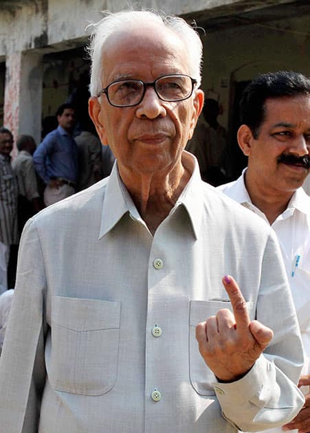 BJP senior leader Kesari Nath Tripathi shows his ink marked finger after casting vote for 8th phase of Lok Sabha Election in Phulpur.
