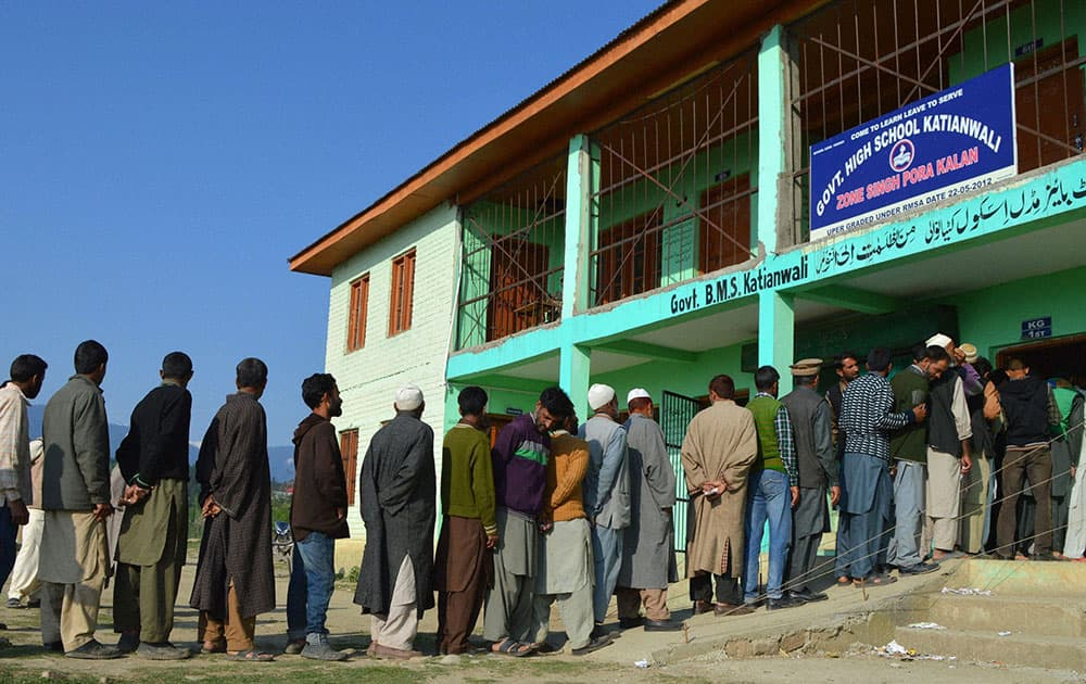 People in a long queue to cast their votes during the 8th phase of Lok Sabha elections,at Katianwali in District Baramulla 65 km`s from Srinagar.
