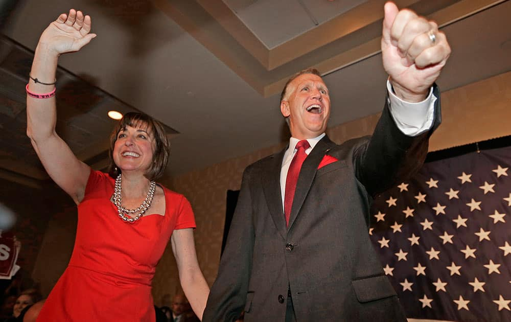 Thom Tillis, right, and his wife Susan Tillis, left, greet supporters at a election night rally in Charlotte, N.C., after winning the Republican nomination for the US Senate.