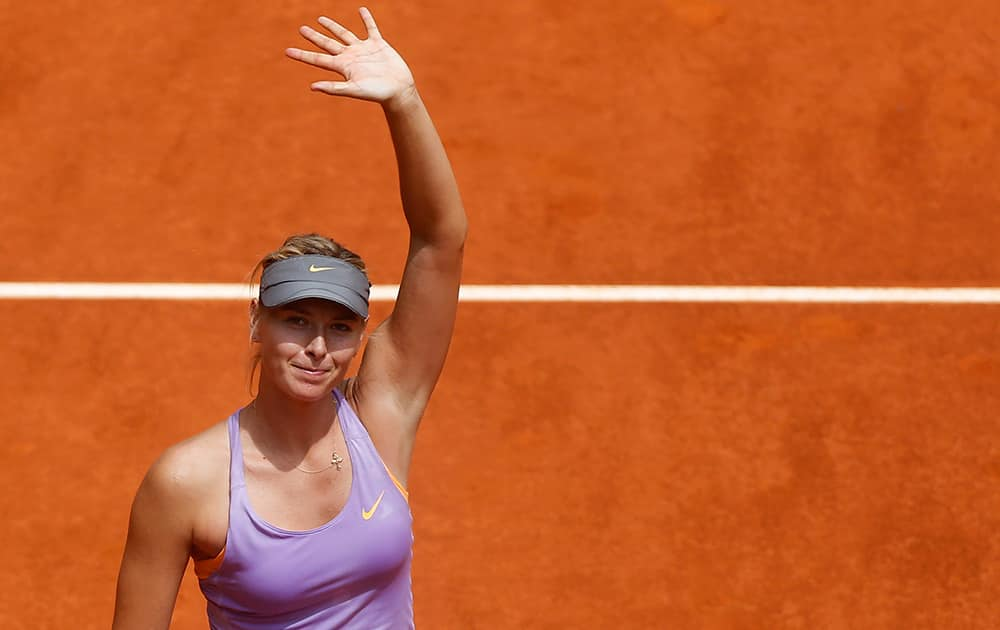 Maria Sharapova from Russia celebrates her victory during a Madrid Open tennis tournament match against Christina McHale from US, in Madrid, Spain.