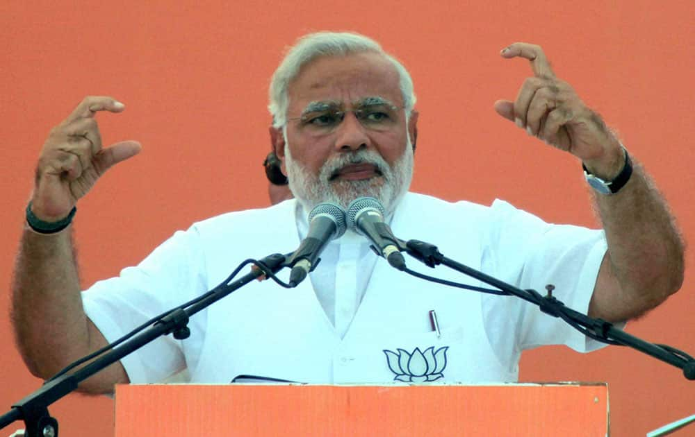BJP PM candidate Narendra Modi addresses an election rally in Amethi.