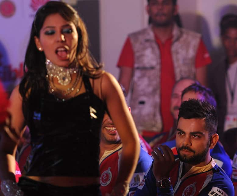 Royal Challengers Bangalore skipper Virat Kohli watches a dancer during a meet and greet promotional event organised in Bangalore. dna