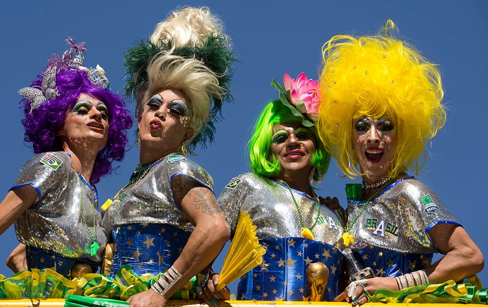 Revelers pose for photos during the annual Gay Pride Parade in Sao Paulo, Brazil.