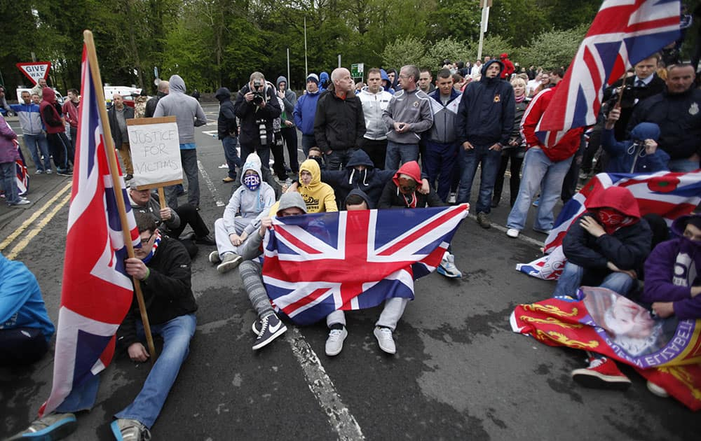 Loyalist protesters form a sit down protest outside Antrim Police Station, Northern Ireland.