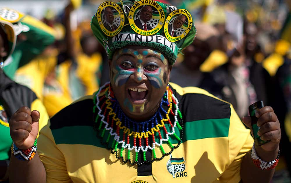 A woman sporting headgear with portraits of South African president Jacob Zuma attends a final African National Congress (ANC) election rally in Soweto, on the edge of Johannesburg.