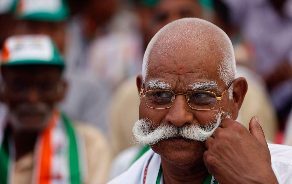 A Congress party supporter listens to Vice President Rahul Gandhi address an election campaign in Amethi, in the northern Indian state of Uttar Pradesh.