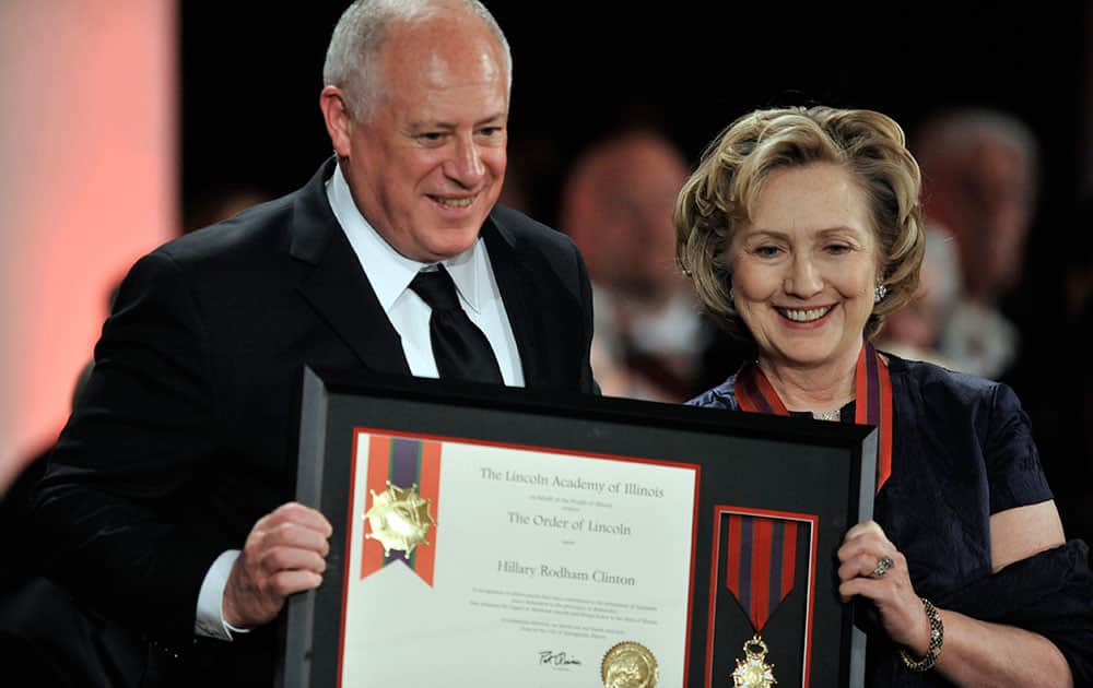Hillary Rodham Clinton is presented the Order of Lincoln Award by Illinois Gov. Pat Quinn at the Field Museum in Chicago.