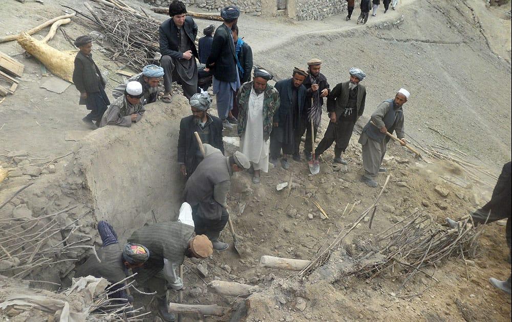 Afghans search for survivors buried after Friday`s landslide in Abi-Barik village in Badakhshan province, northeastern Afghanistan.