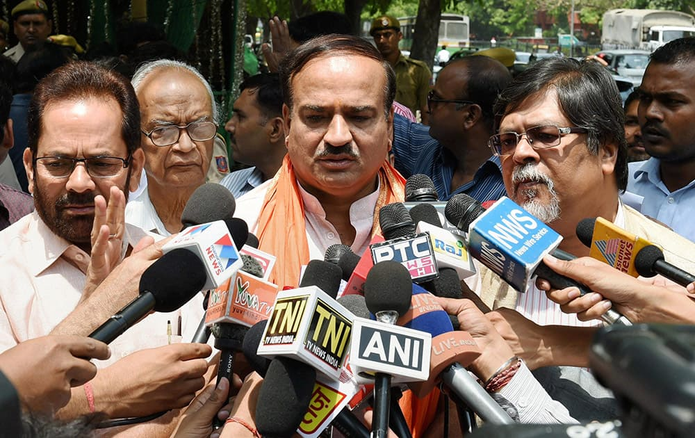 BJP leaders Ananth Kumar, Mukhtar Abbas Naqvi and Chandan Mitra talking to media after meeting with CEC at Election Commission office in New Delhi.