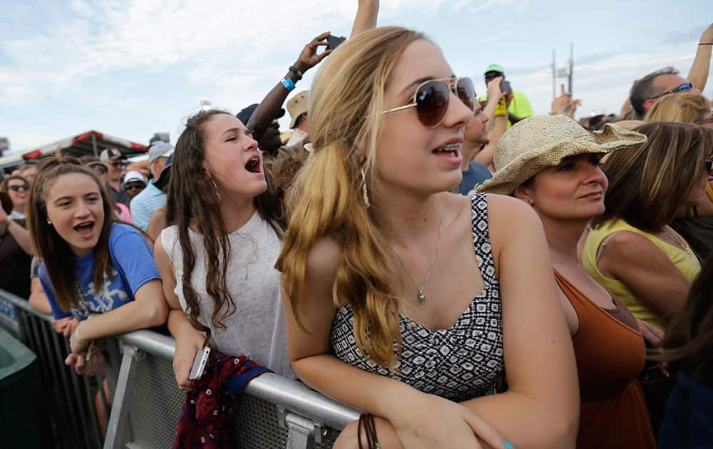 Fans cheer as Christina Aguilera performs at the New Orleans Jazz and Heritage Festival in New Orleans.