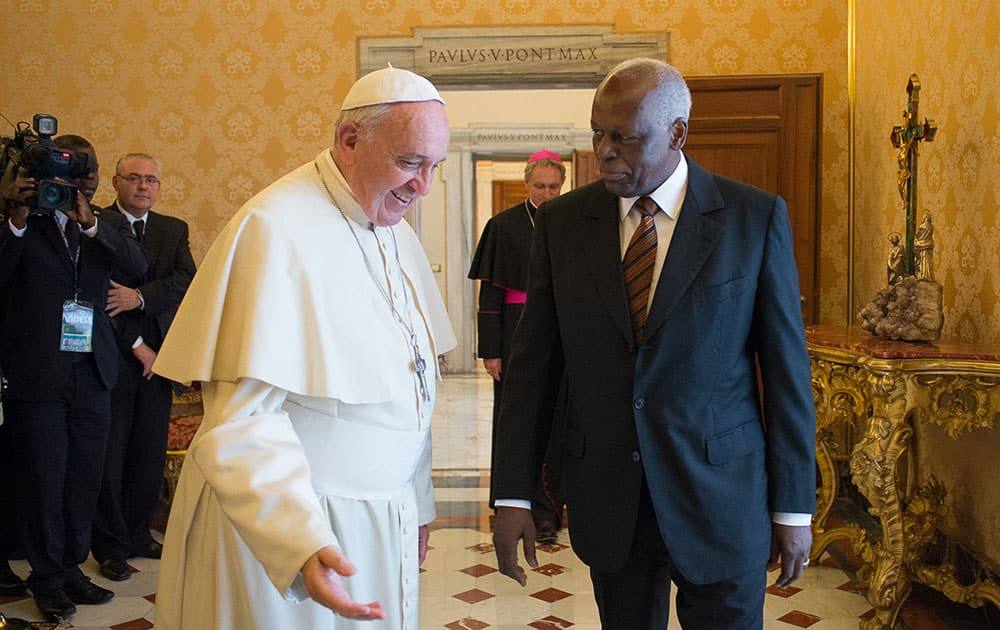 This photo provided by the Vatican newspaper L`Osservatore Romano, Pope Francis exchanges gifts with Angola`s President Angola Jose Eduardo Dos Santos, during a private meeting at the Vatican.