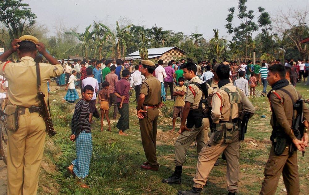 Security personnel at Narsingbari where some people were killed by militants in Baksa district of Assam.