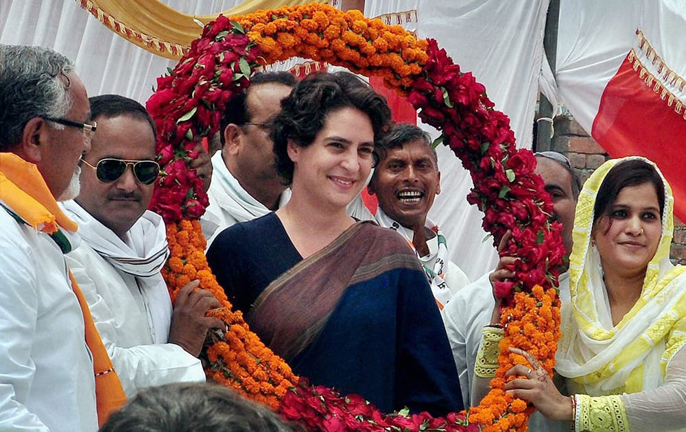 Priyanka Vadra being welcomed by party workers during an election campaign meeting in Amethi.