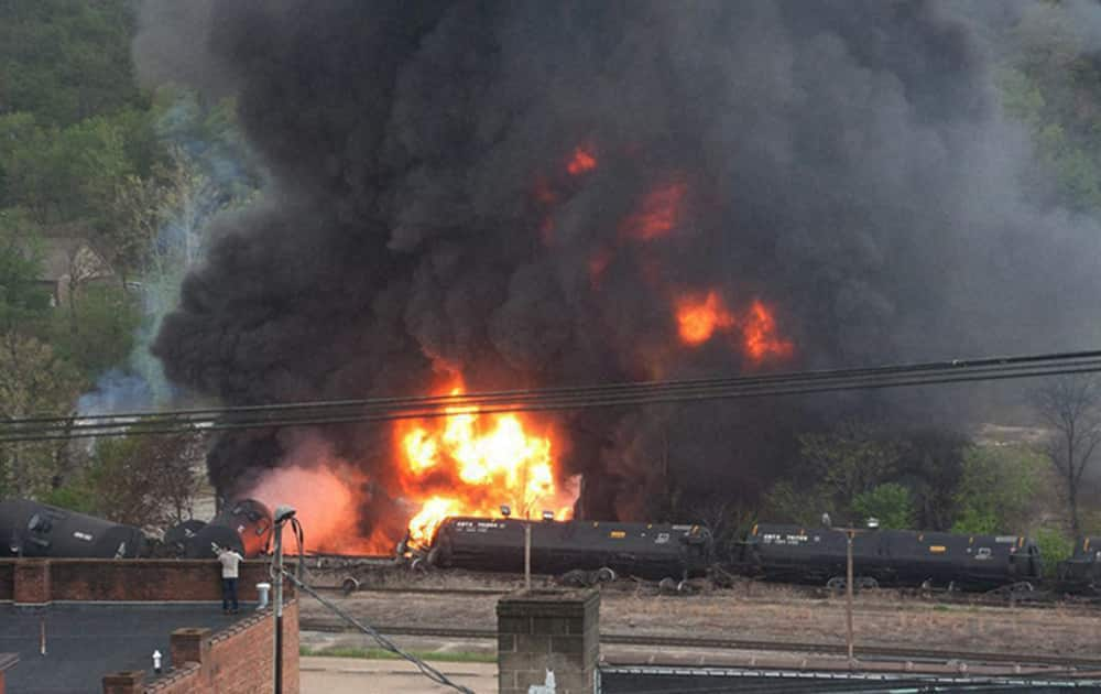 This image made available by the City of Lynchburg, shows several CSX tanker cars carrying crude oil in flames after derailing in downtown Lynchburg, Va.