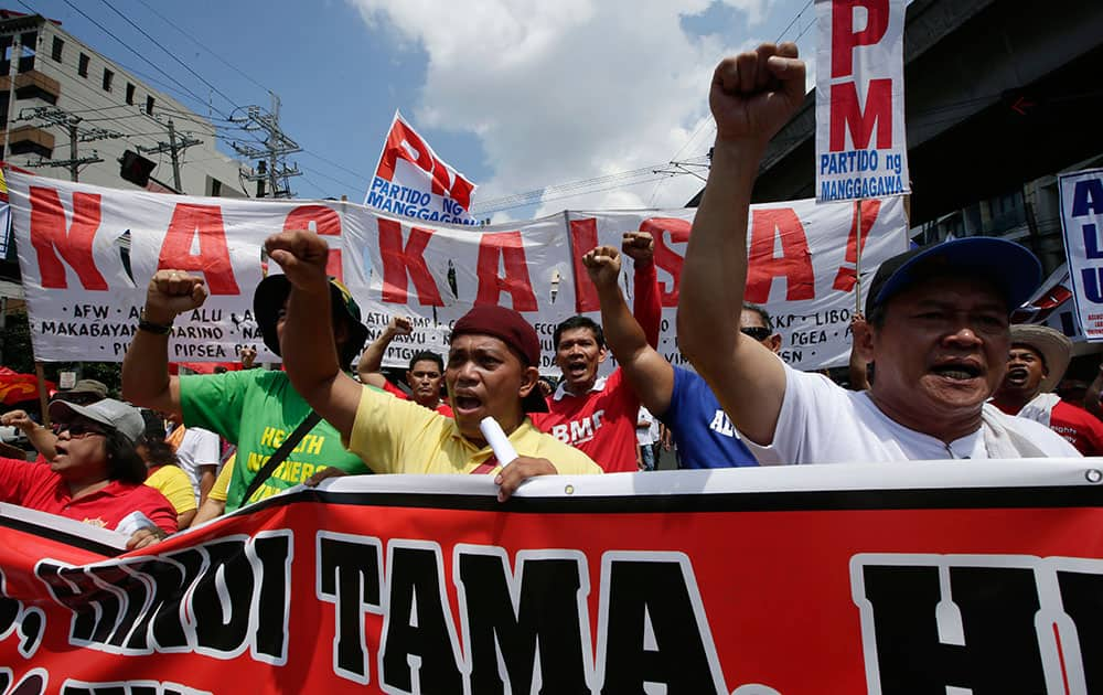 Workers shout slogans as they march towards the Presidential Palace to mark the Labor Day celebrations, in Manila, Philippines.