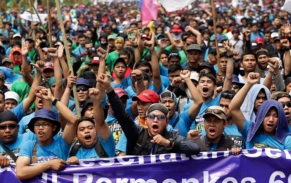 Indonesian workers shout slogans during a May Day rally in Jakarta, Indonesia.