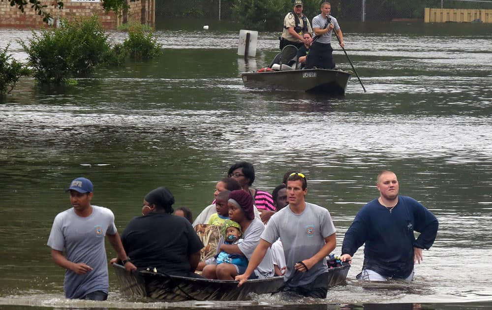 Residents at the Forest Creek Apartments in Pensacola, Fla. Florida are rescued by boat.