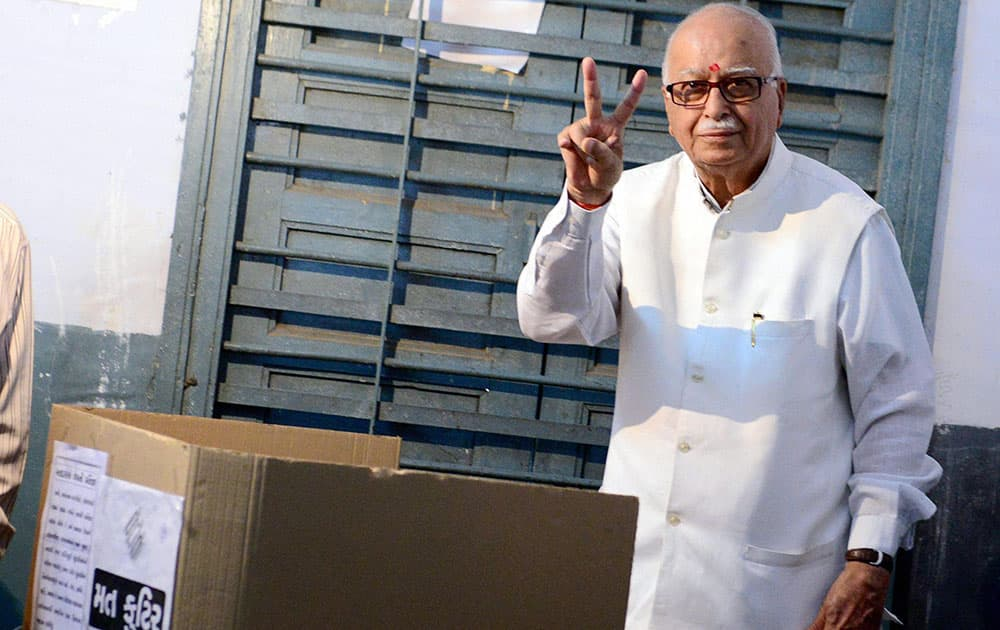 BJP senior leader LK Advani flashes victory sign after casting his vote for Lok Sabha polls at a polling station in Ahmedabad.