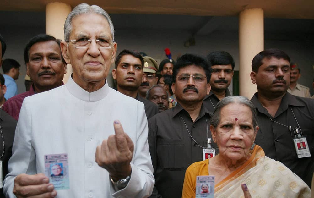 Uttar Pradesh Governor B L Joshi and his wife cast their vote in Lucknow.