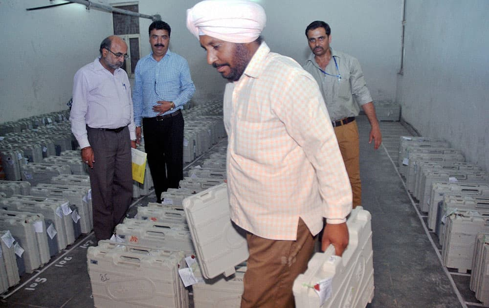Polling officials at an EVM distribution centre in Hyderabad on Tuesday ahead of elections.