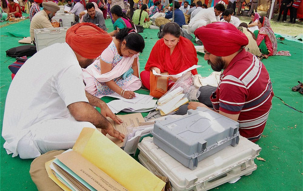 Polling parties collect election material for Lok Sabha polls in Patiala.