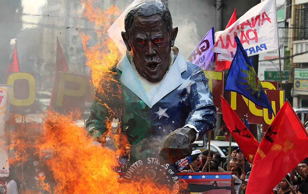 An effigy of US President Barack Obama is burned by Filipino activists during a rally outside the Malacanang presidential palace in Manila, Philippines to oppose the Enhanced Defense Cooperation Agreement between the Philippines and US.