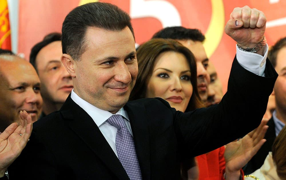 Macedonian Prime Minister and leader of the ruling conservative VMRO-DPMNE Nikola Gruevski, rises his fist while announcing a double victory in parliamentary and presidential elections, in Skopje, Macedonia.