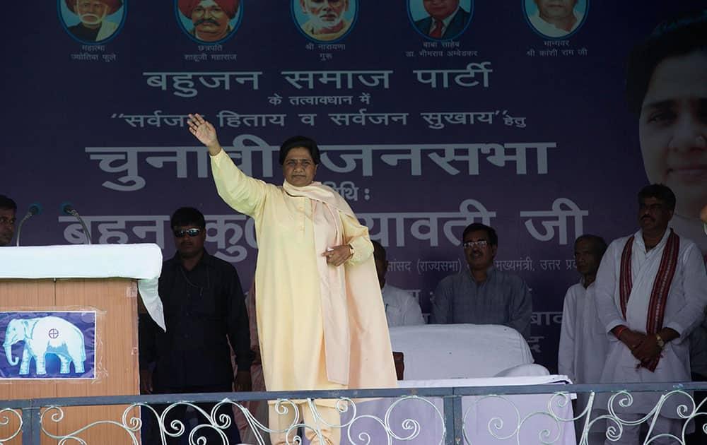 Bahujan Samaj Party president Mayawati waves to supporters at an election rally in Allahabad, Uttar Pradesh state, India.