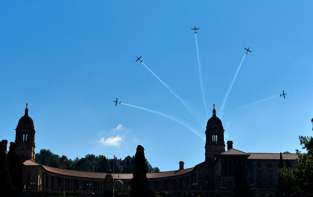 Aircraft perform a flyover above the government`s Union Buildings in Pretoria, South Africa, during 20-year Democracy Anniversary celebrations.