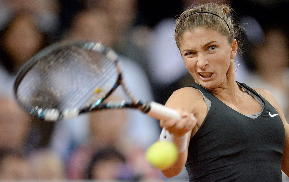 Sara Errani of Italy returns the ball to Russia`s Maria Sharapova during their semifinal match at the Porsche tennis Grand Prix in Stuttgart, Germany.