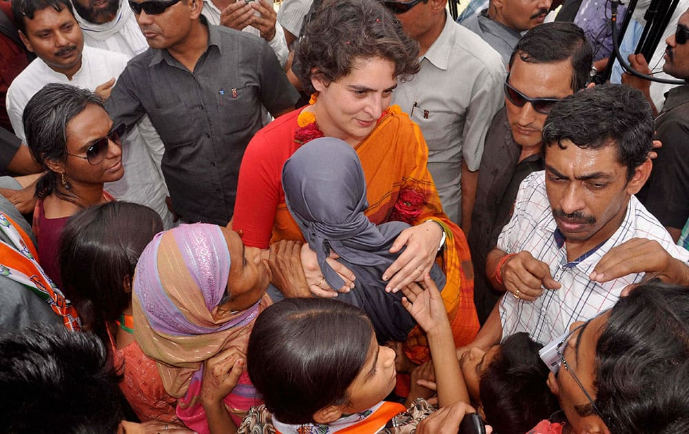 Priyanka Vadra interacts with people during an election campaign for her brother and Congress Vice President Rahul Gandhi in Amethi.