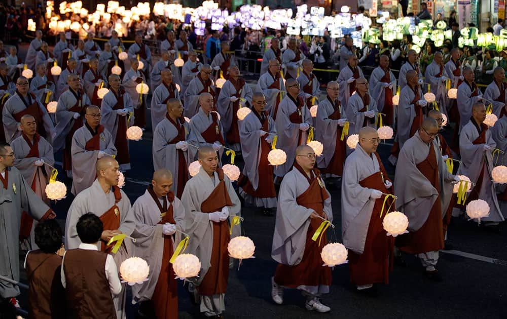 South Korean Buddhist monks carry lanterns in a parade for cherishing the memory of deceased persons and safe return of passengers aboard the sunken ferry boat Sewol during the Lotus Lantern Festival for upcoming birthday of Buddha on May 6, on a street in Seoul, South Korea.