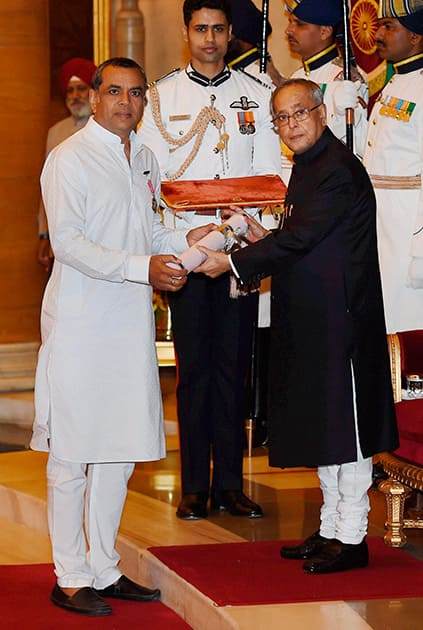 President Pranab Mukherjee presents Padma Shri to actor Paresh Rawal during Padma Awards 2014 function at Rashtrapati Bhavan in New Delhi.