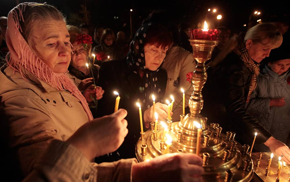 Ukrainians hold lit candles commemorating the 28th anniversary of the Chernobyl nuclear disaster in Kiev, Ukraine.