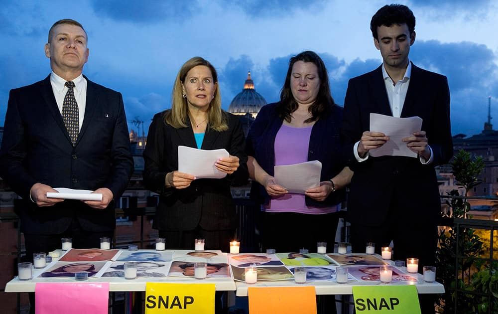 Members of SNAP (Survivors Network of those Abused by Priests), from left, David D`Bonnabel from Austria, President Barbara Blaine from the US, Nicky Davis from Australia, and Miguel Hurtado from Spain read a letter denouncing abuses in Rome.