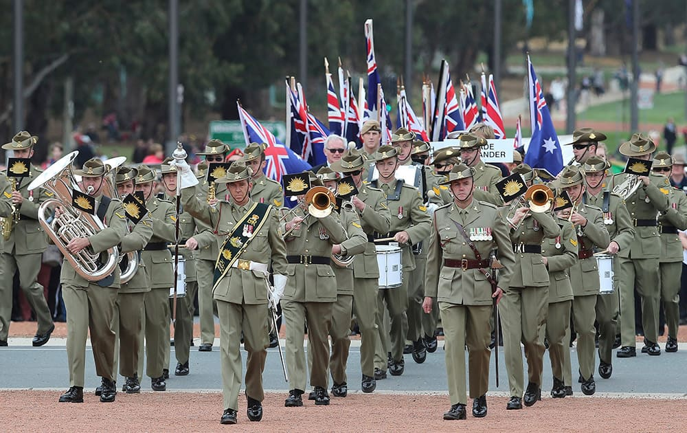 A military band marches onto the parade ground on Anzac Day at the Australian War in Canberra, Australia.