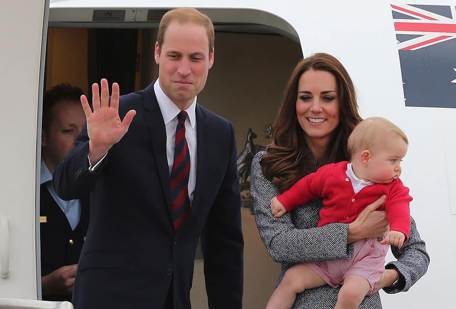 Britain`s Prince William and Kate, the Duchess of Cambridge, along with son Prince George, stand atop of the stairs to say good bye as they board their flight in Canberra, Australia.