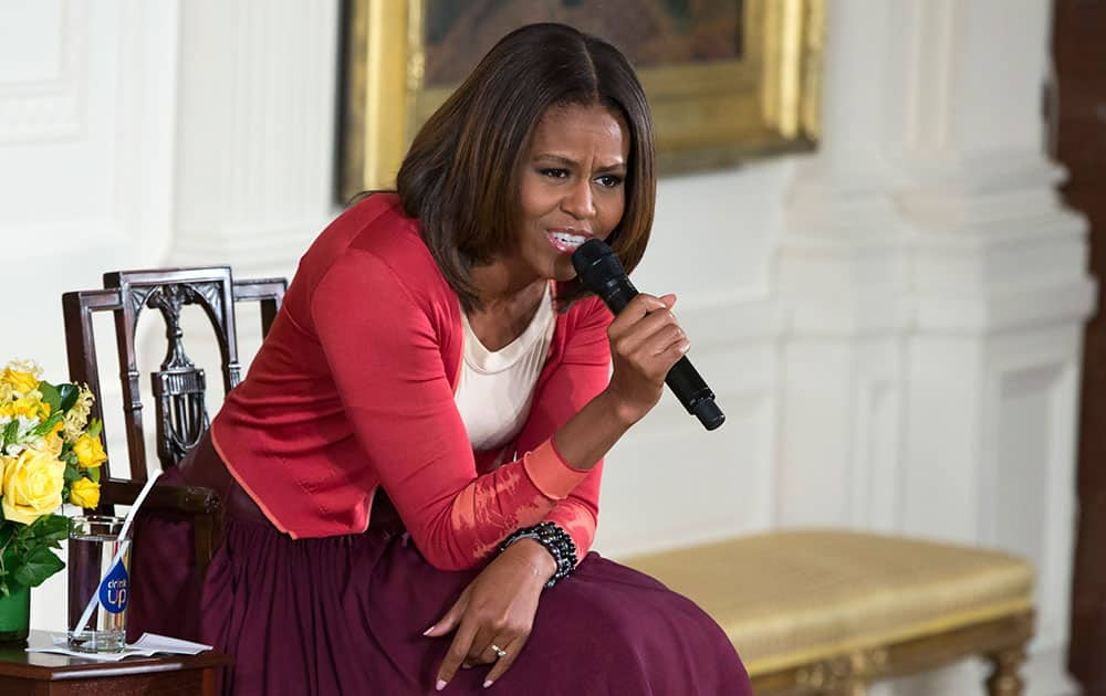First lady Michelle Obama answers questions during the White House`s annual `Take Our Daughters and Sons to Work Day,` , in the East Room of the White House in Washington.