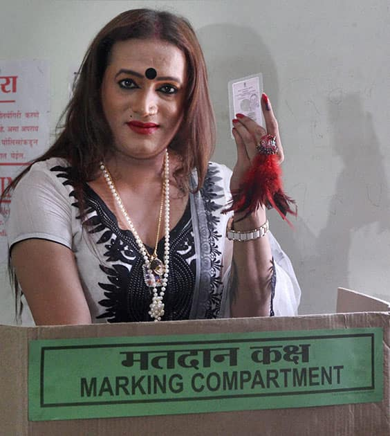 Transgender and social activist Laxmi Tripathi casting vote for Lok Sabha polls at a polling station in Navi Mumbai.